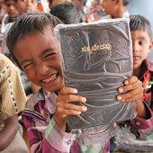 This young boy, who lives in an orphanage run by St Thomas Academy Trust, was happy to get a Bible from the Bible Society of India.