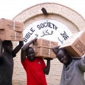 Young 'boda boda' (motorcycle taxi) drivers in Juba, South Sudan, helped unload a large consignment of Bibles for free as their service to the Bible Society. 'This is our Bible Society,' they told Executive Secretary Edward Kajivora, as they carried the heavy boxes into the warehouse.