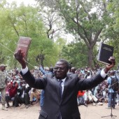 """Here is your Bible!"" Bible Society of Cameroon General Secretary Luc Gnowa said to the 5,000 Musgum Christians gathered at the launch of the very first Musgum Bible in the town of Pouss in Cameroon, on May 28, 2016. http://ubscommunity.org/blog/2016/06/29/les-musgums-du-ce-dans-la-liesse-2/"