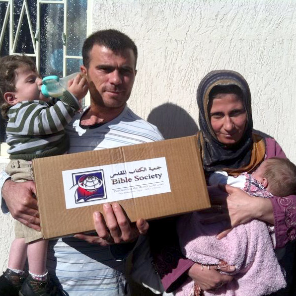 Syrian refugees receiving relief packages and Scriptures from the Bible Society of Lebanon