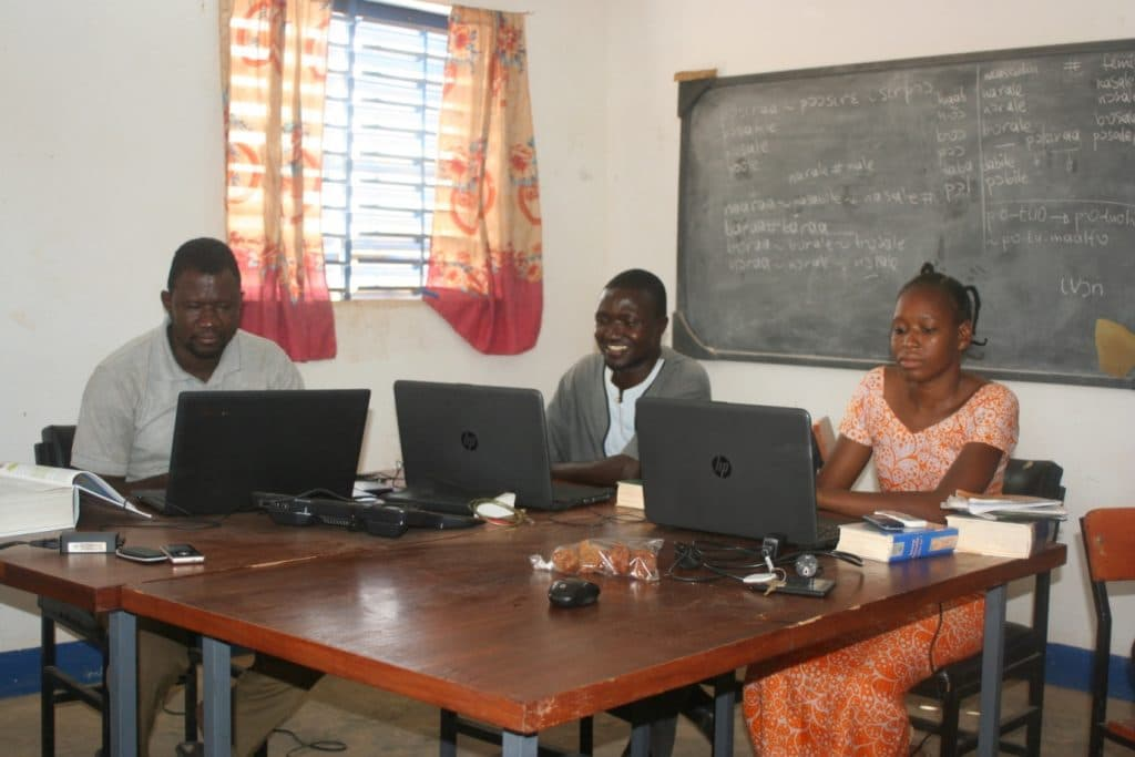 The Birifor Bible translation team. From left to right : project coordinator Pascal Hien, Dimitri Kambou and Nathalie Da.
