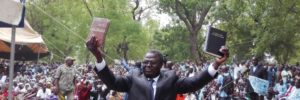 """""""Here is your Bible!"""" Bible Society of Cameroon General Secretary Luc Gnowa said to the 5,000 Musgum Christians gathered at the launch of the very first Musgum Bible in the town of Pouss in Cameroon, on May 28, 2016."""