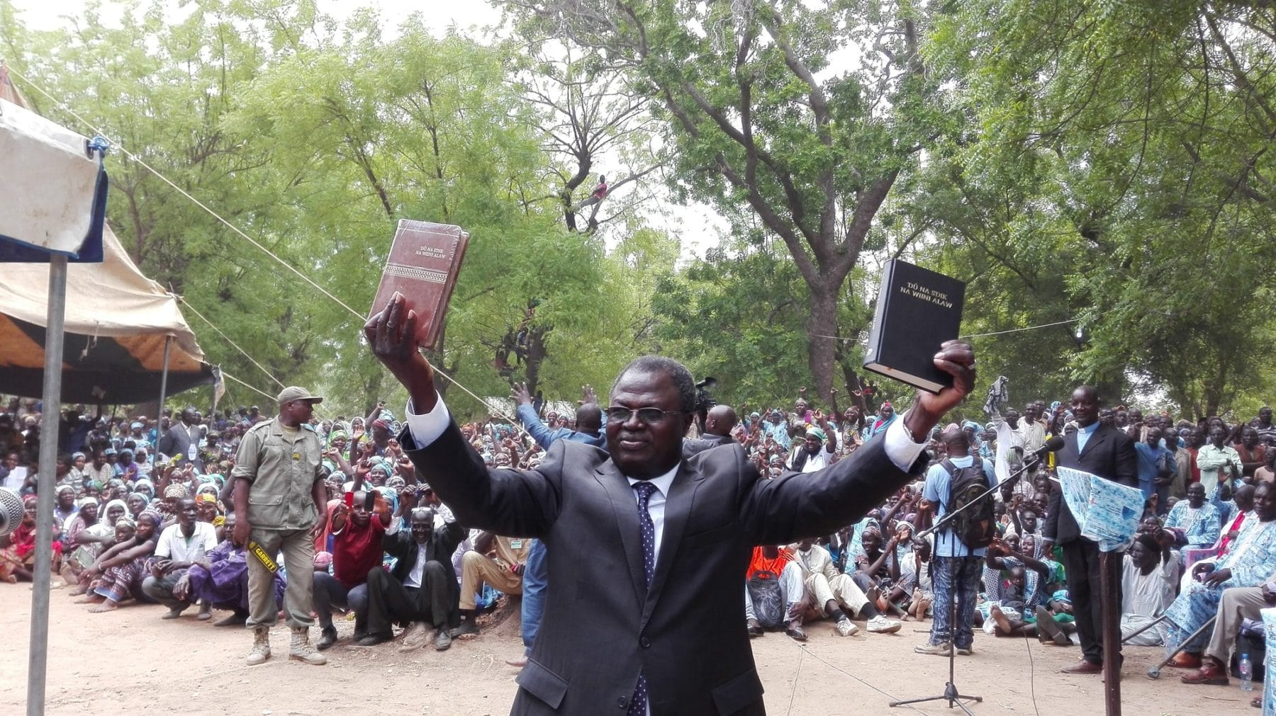 """Here is your Bible!"" Bible Society of Cameroon General Secretary Luc Gnowa said to the 5,000 Musgum Christians gathered at the launch of the very first Musgum Bible in the town of Pouss in Cameroon, on May 28, 2016."